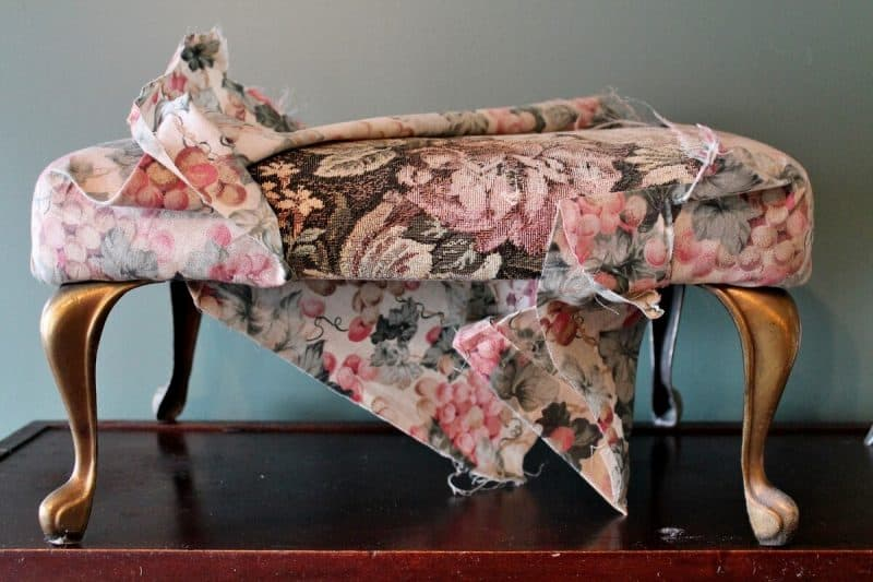 taking upholstery off a vintage stool