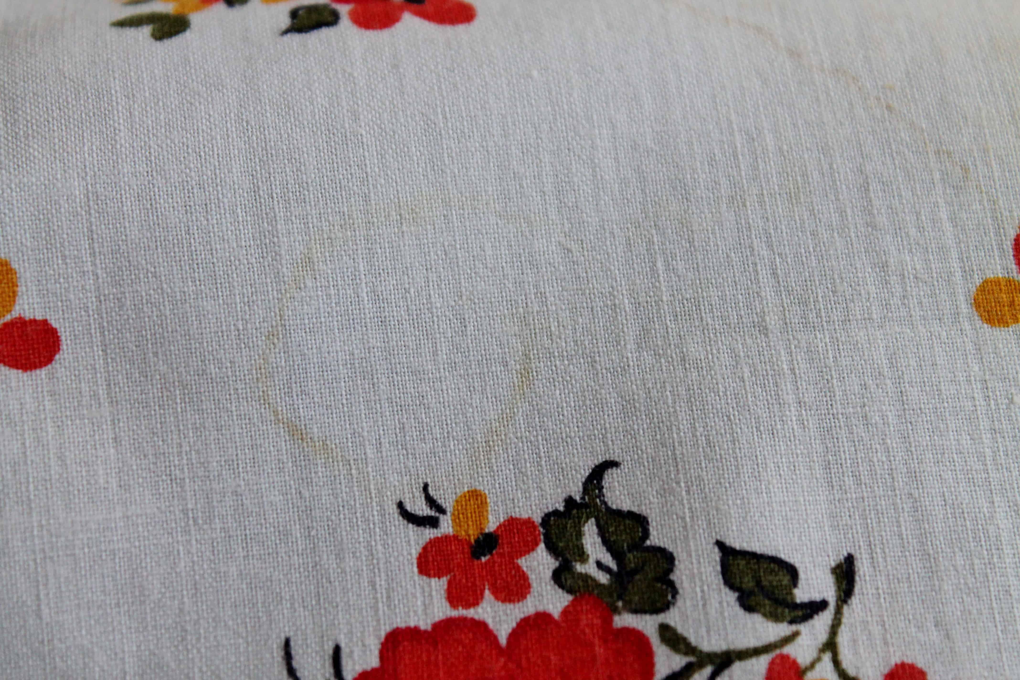 Scorch mark diminished on vintage apron