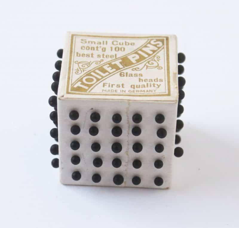 Cube of vintage German straight pins