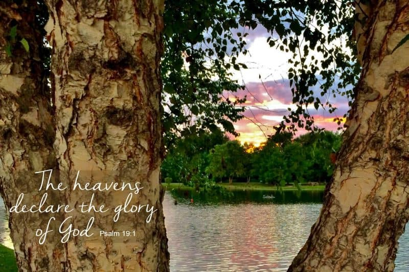 Beautiful sunset over lake with scripture