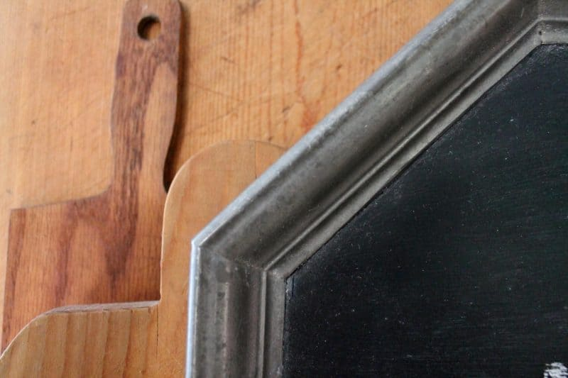close up of vintage pewter tray with chalkboard paint