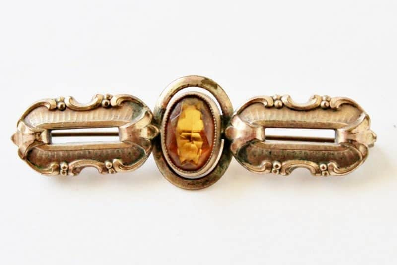 antique bar pin with topaz colored stone