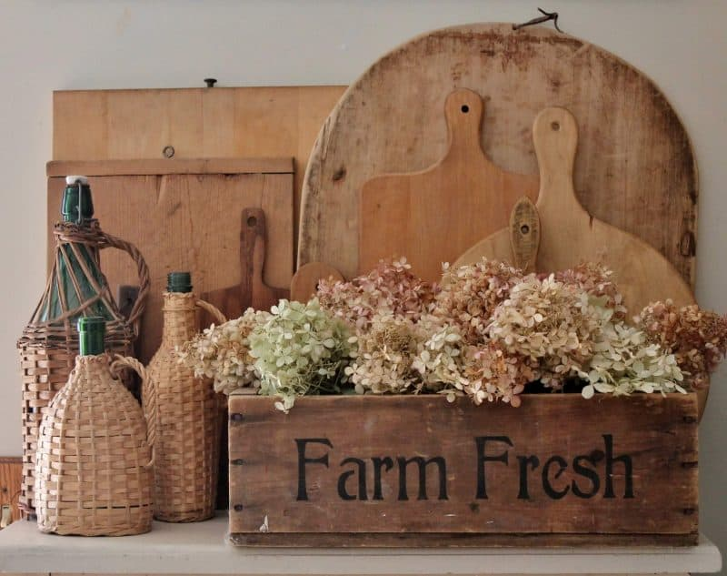 Farm Fresh crate with bread boards and rattan covered bottles