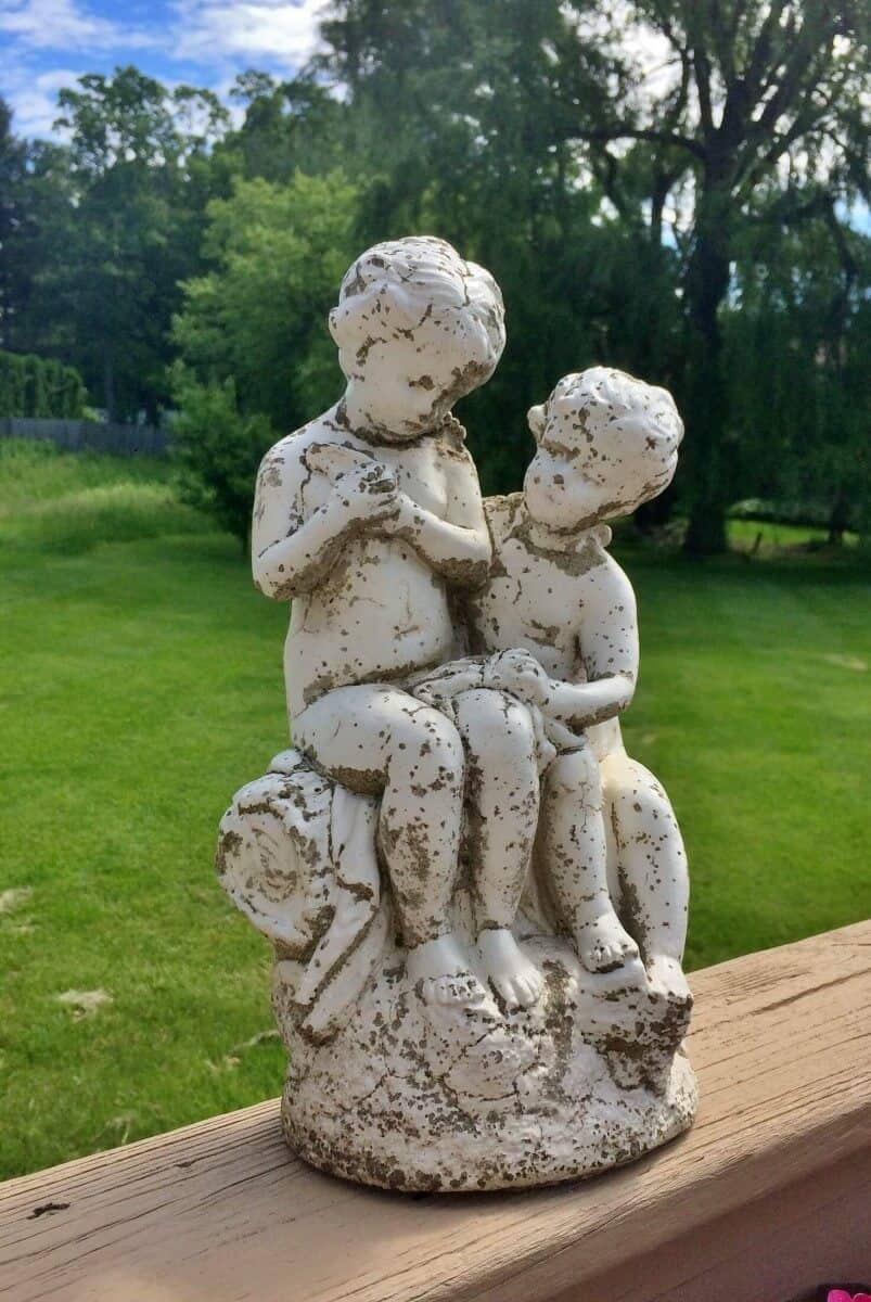 Vintage concrete statue of two cherubs