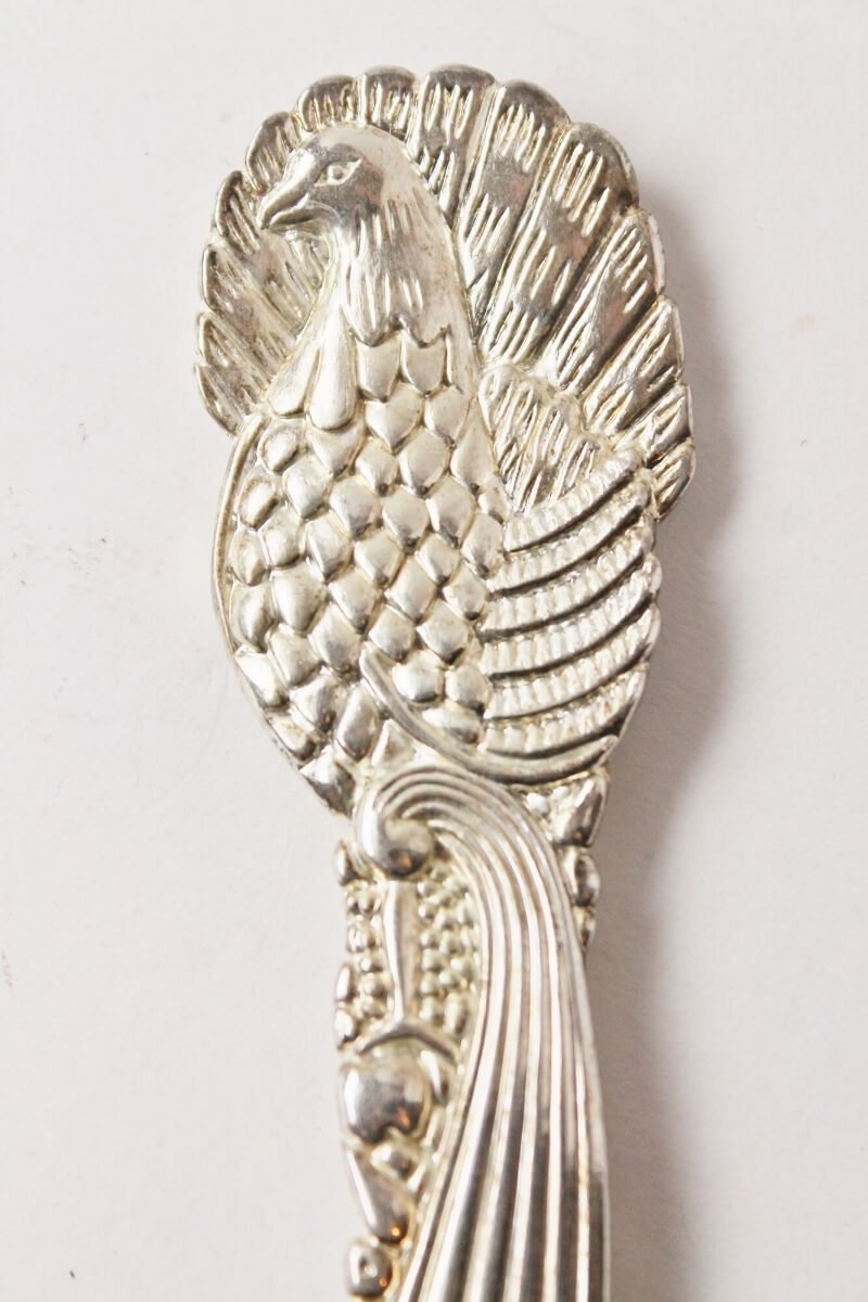 Silver plated peacock serving spoon